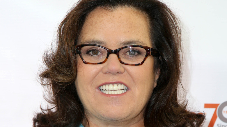 Rosie O'Donnell smiles on the red carpet
