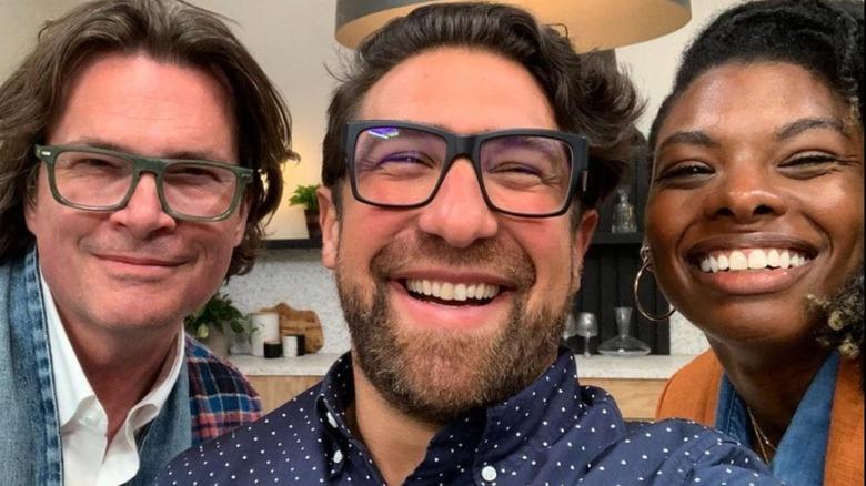 Chris Goddard, Eli Hariton, and Carmeon Hamilton smiling in a selfie