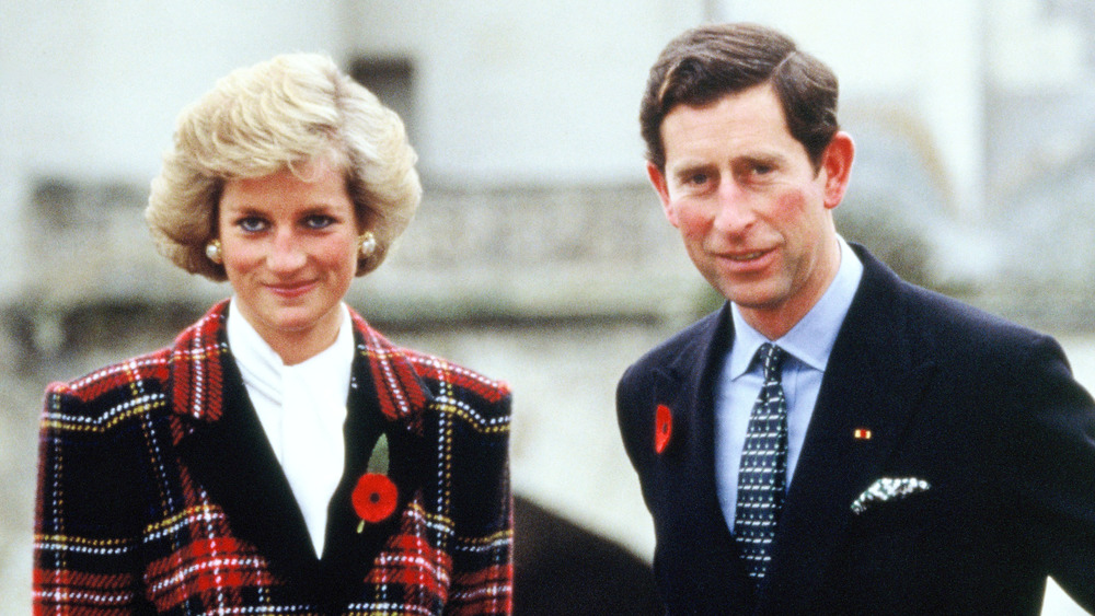 Prince Charles and Princess Diana wearing red flowers