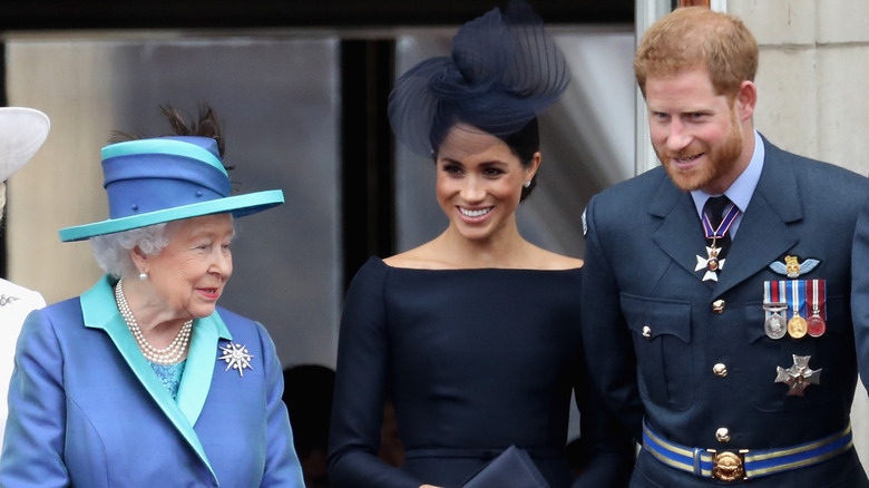 Queen Elizabeth II and Meghan Markle and Prince Harry
