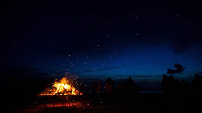 Image of person celebrating the summer solstice with bonfire