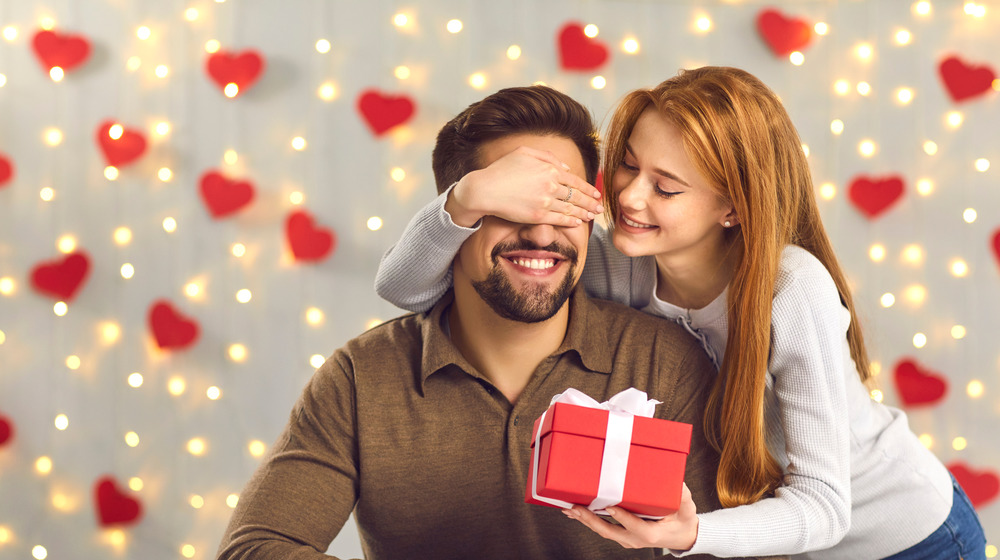 Woman giving man a gift