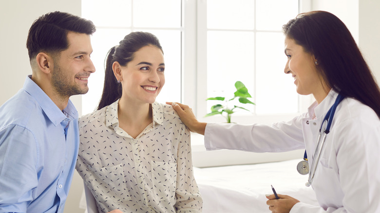 Couple speaking to doctor