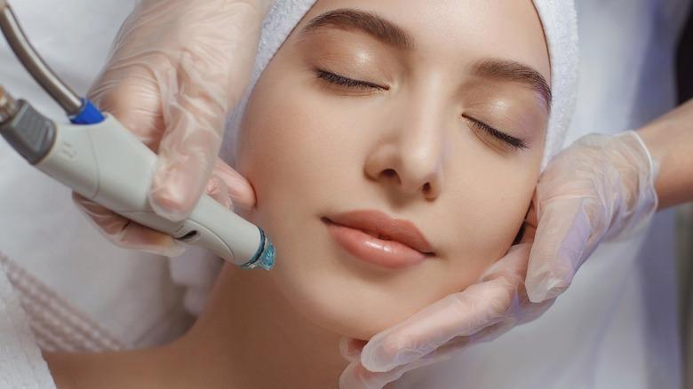 women getting face laser treatment