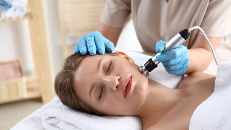 Woman receiving Thermage on her face