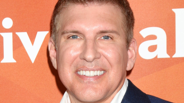 Todd Chrisley smiling on red carpet