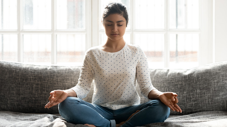 Young woman practicing transcendental meditation