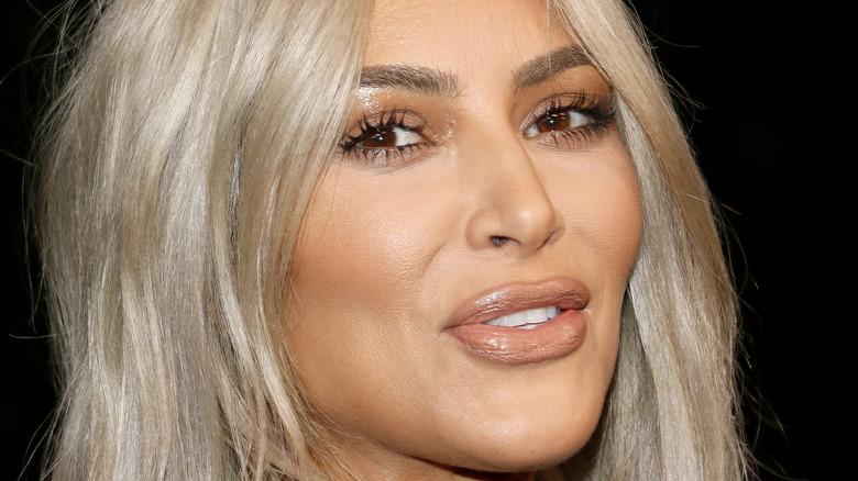 Kim Kardashian smiles for the camera.