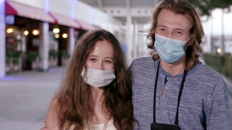 Alina and Steven smiling with masks on