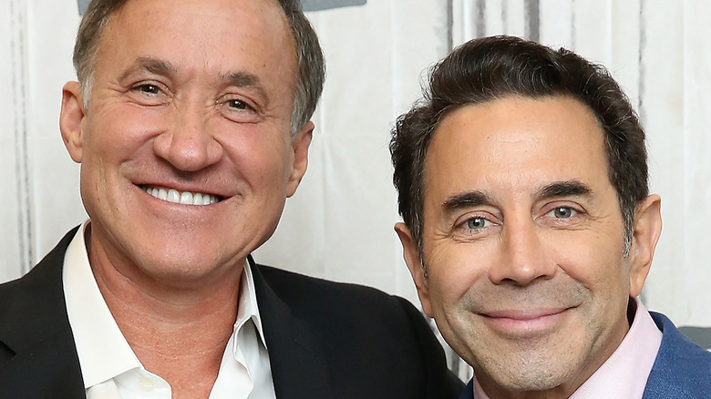 Dr. Terry Dubrow and Dr. Paul Nassif posing