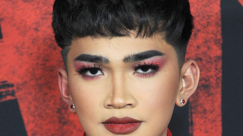 Bretman Rock, red lipstick, purple eye shadow