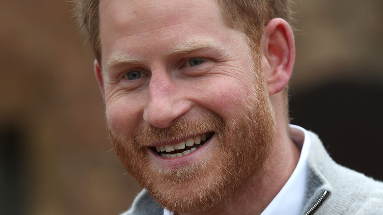 Prince Harry laughng at a royal event