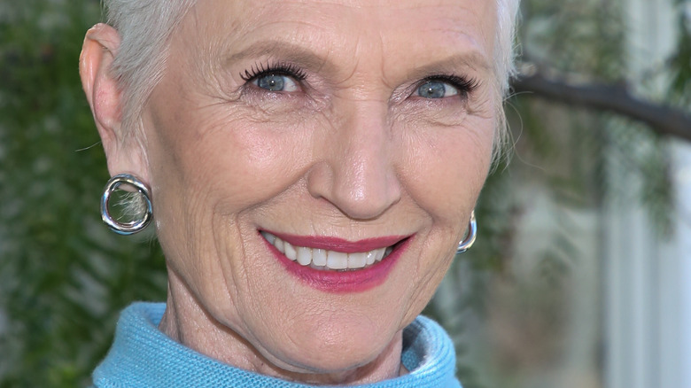 Maye Musk wears blue and smiles