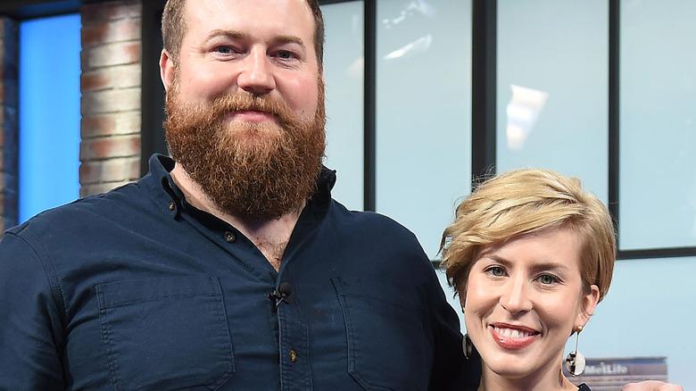 Ben Napier and Erin Napier pose