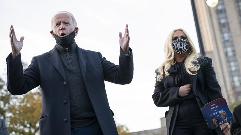 Lady Gaga and Joe Biden outside wearing face masks