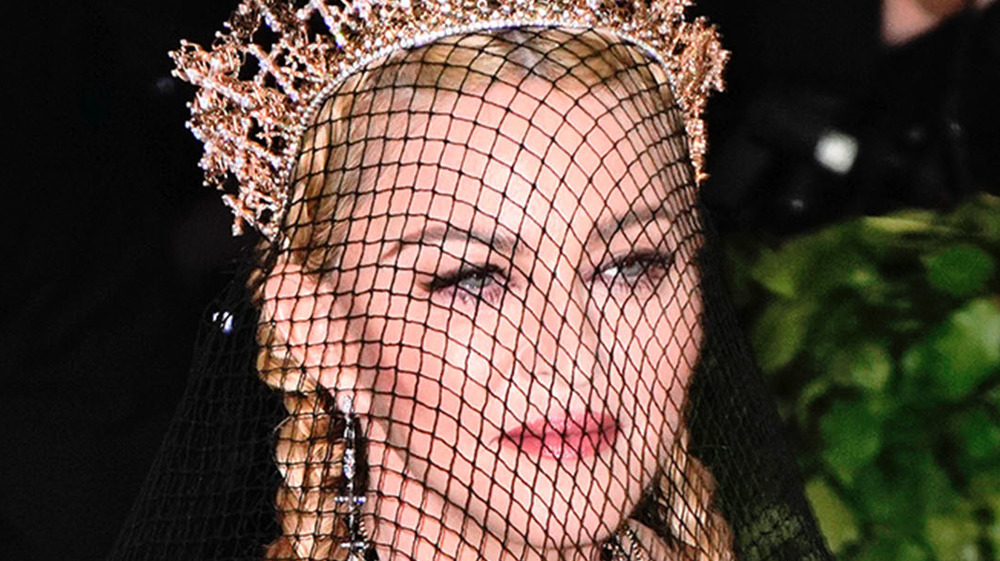 Madonna wearing netted veil