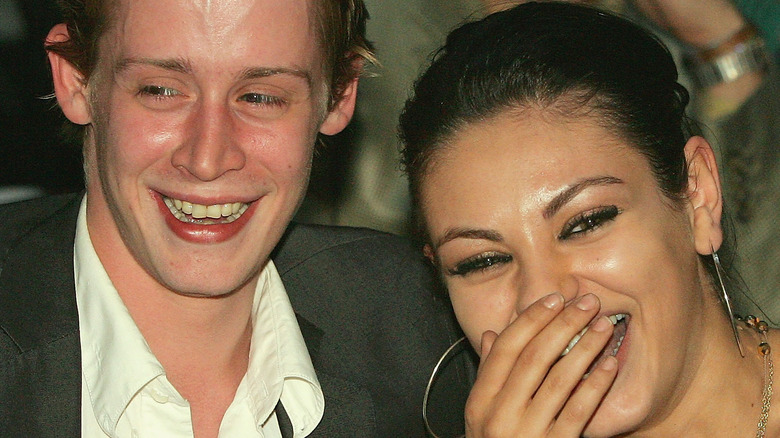 Mila Kunis and Macaulay Culkin enjoy a laugh