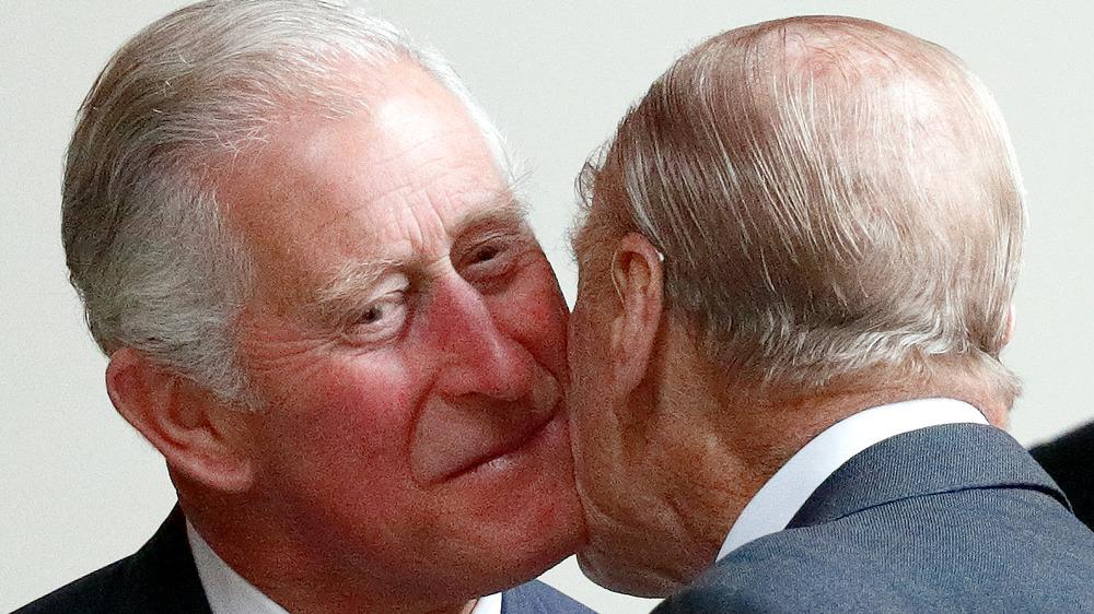 Prince Charles saying hello to Prince Philip