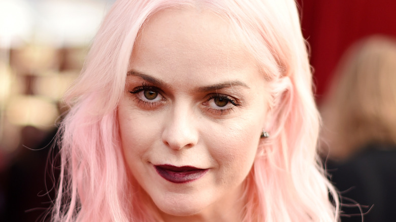 Taryn Manning poses at an event