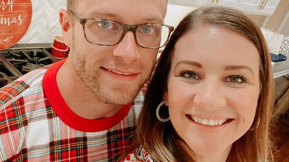 Adam and Danielle Busby of TLC's OutDaughtered posing for a selfie on Instagram