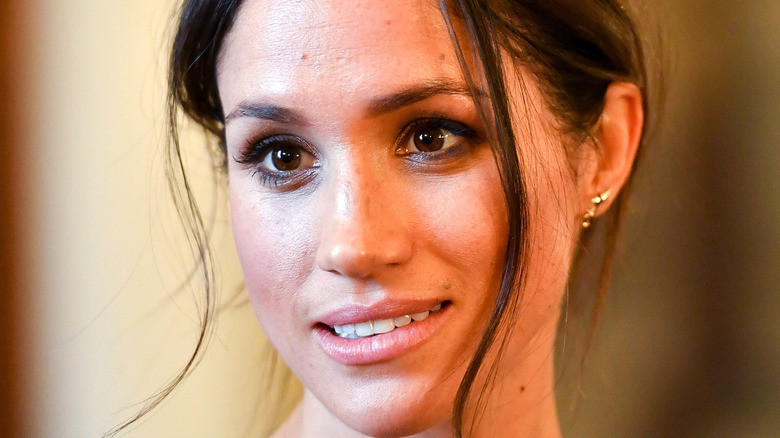 Meghan Markle smiling at an event.
