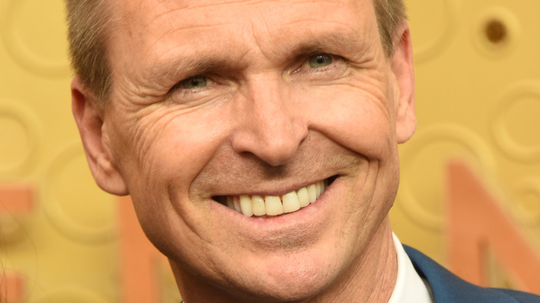 phil keoghan attending an event