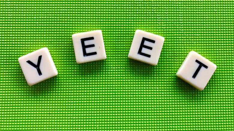Scrabble tiles reading 'yeet'