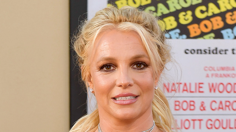 Britney Spears smiles on the red carpet in red dress
