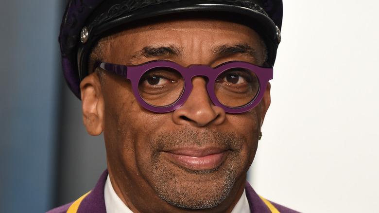 Spike Lee posing, purple glasses