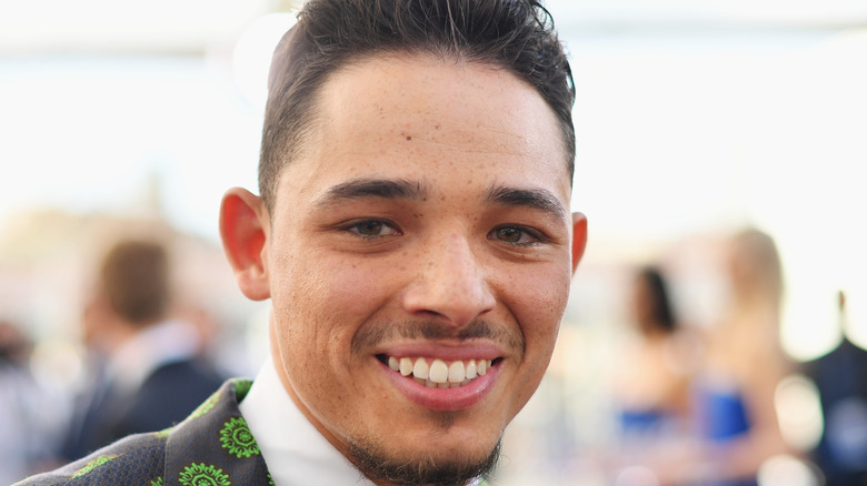 Anthony Ramos smiles for the camera