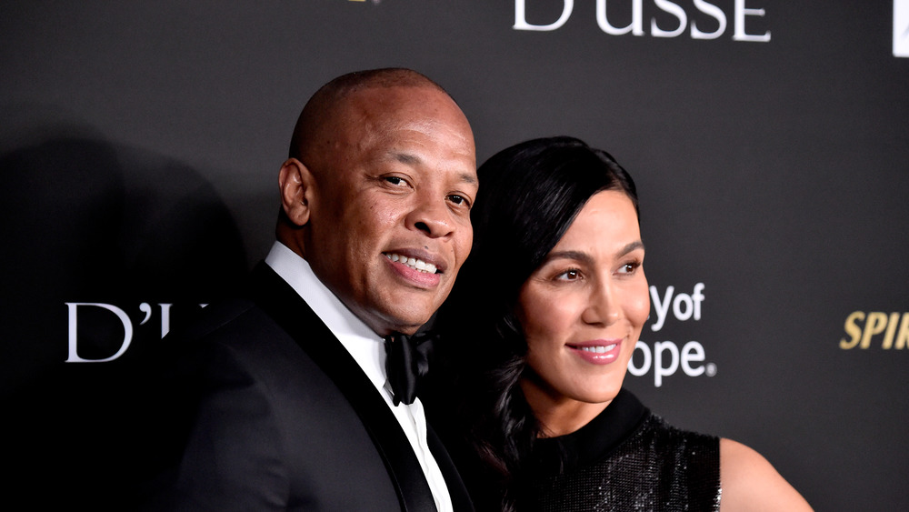 Dr. Dre and Nicole Young on red carpet