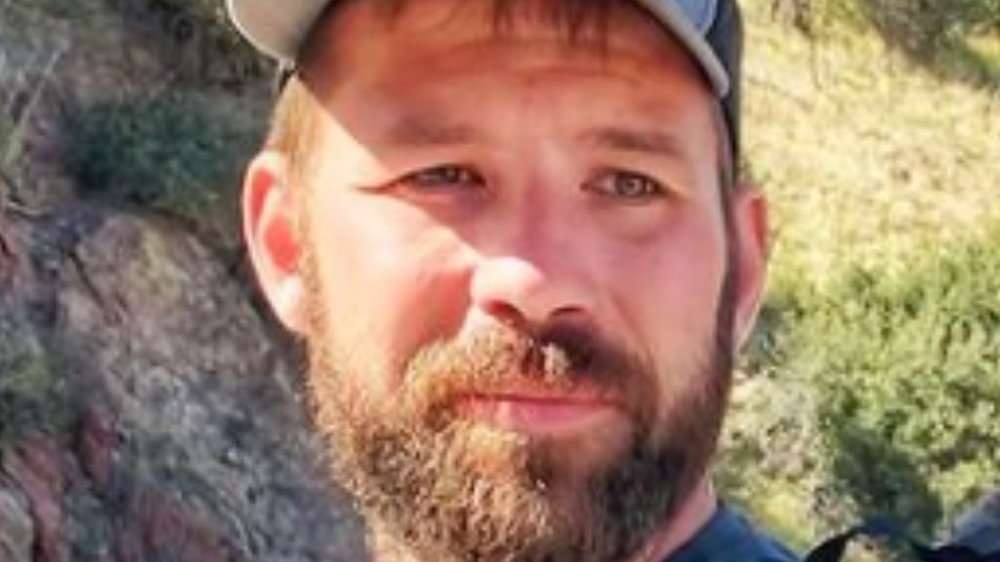 Dr. Cody Creelman in baseball hat with beard