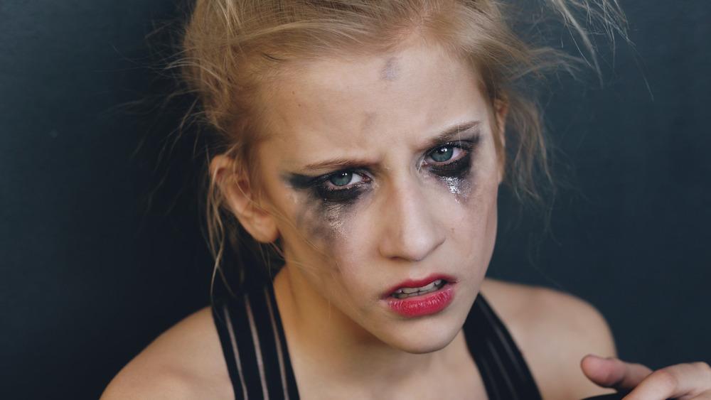 Sad woman with smudged makeup