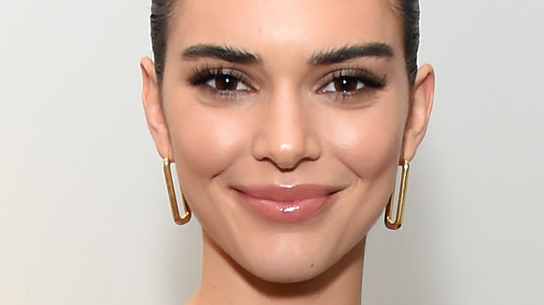 Kendall Jenner giving peace sign