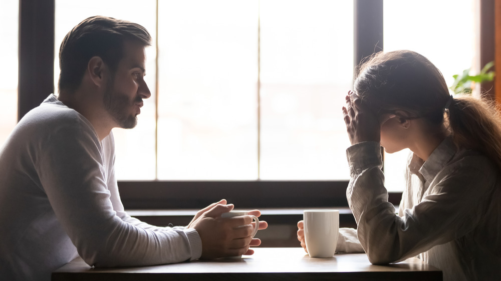 couple having difficult conversation over coffee
