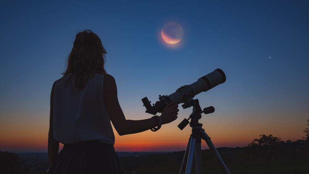 Woman looking at an eclipse