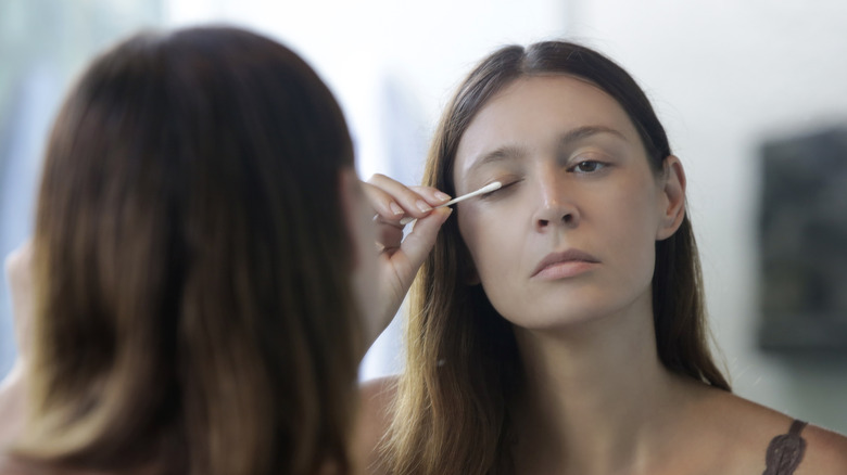 Woman applying Latisse to her lashes