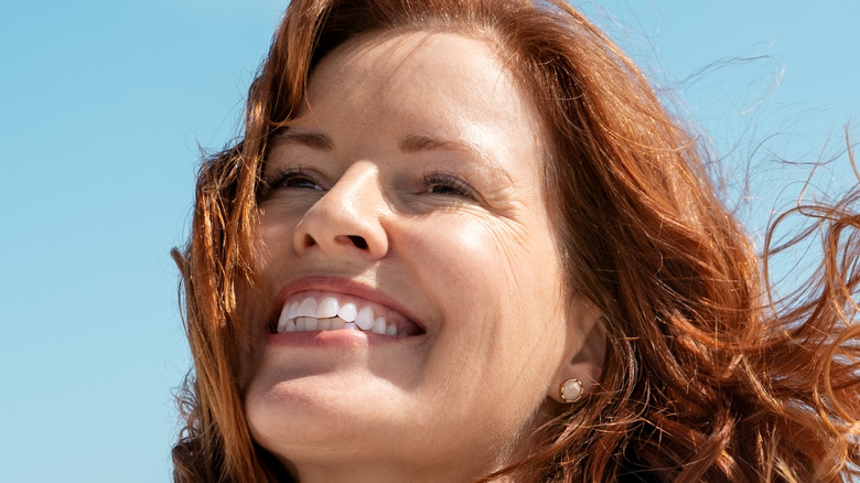 Woman smiling while on the beach