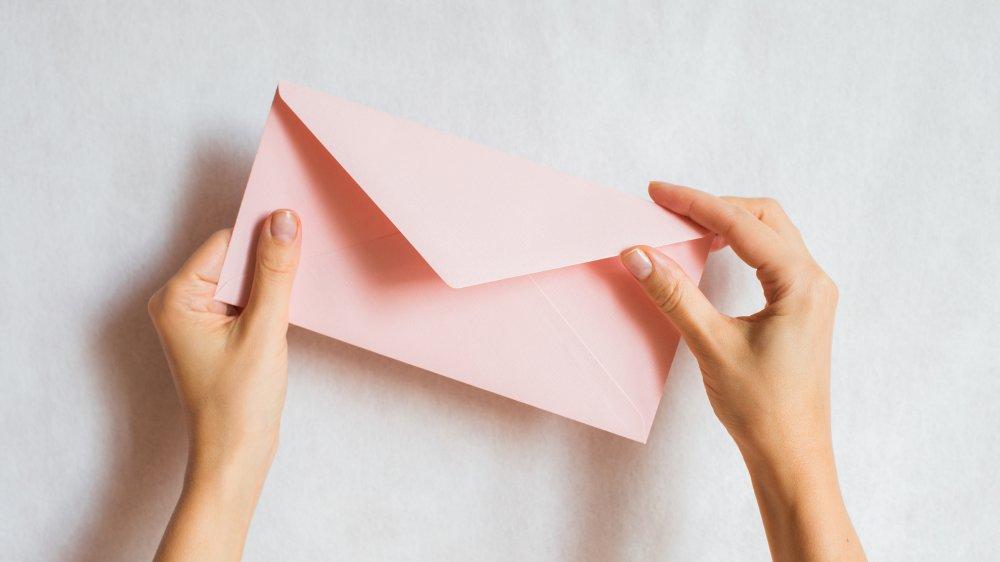 woman holding an envelope
