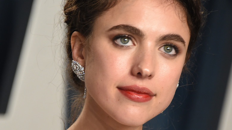 Margaret Qualley with an updo'