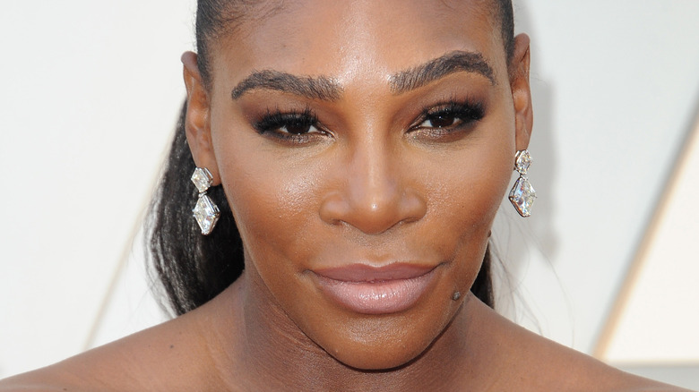 Serena Williams looking up, smiling