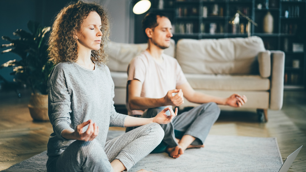 Meditative couple in living room