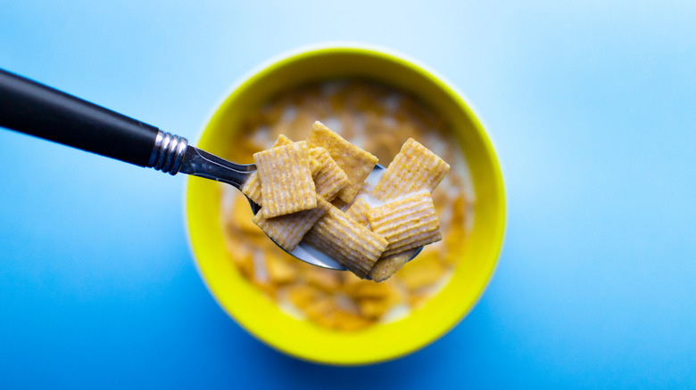 A bowl of cereal and spoon