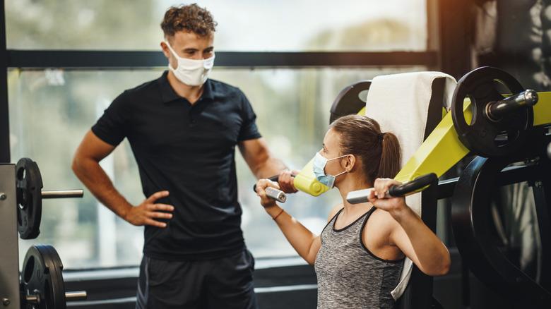 Gym members wear masks