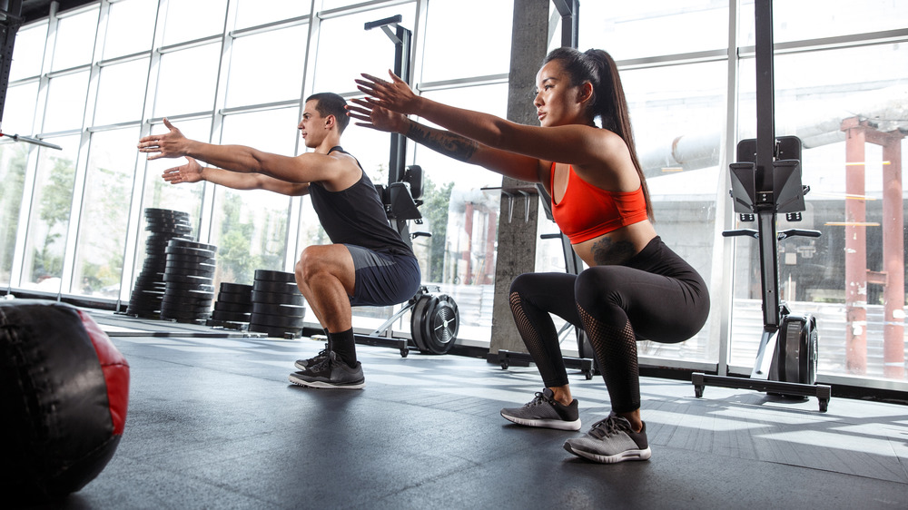 Man and woman workout squats