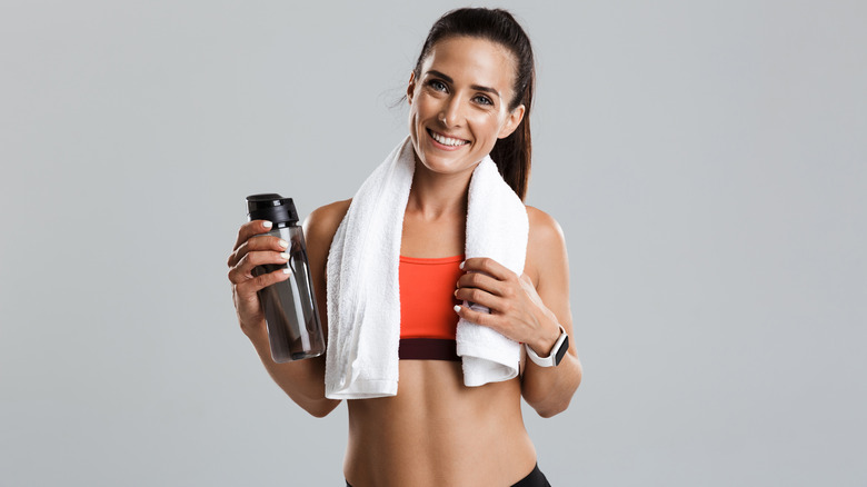 Woman smiling in workout clothes