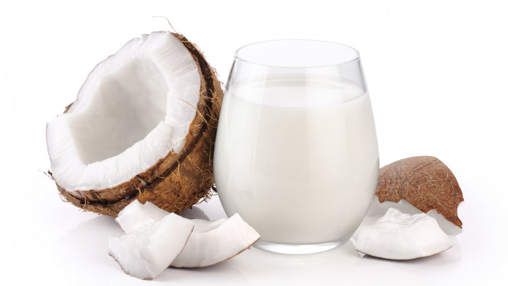 coconuts with a glass of coconut milk