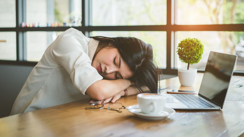 A tired woman with a cup of coffee