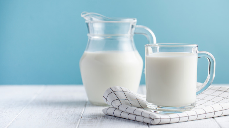 A pitcher and glass of milk
