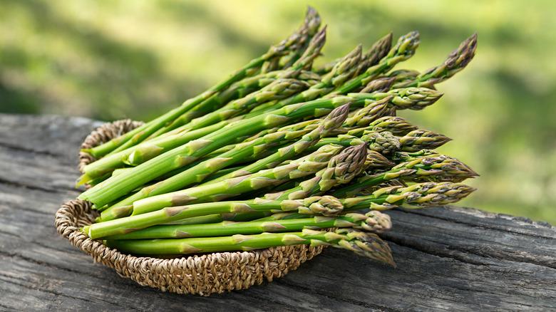 Asparagus stalks in woven basket